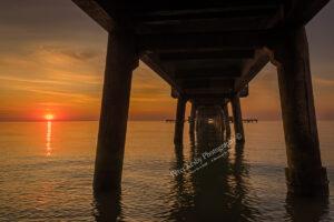 AK036 under deal pier sunrise right web