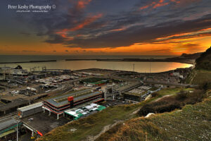 AF010 sunset over harbour from cliffs