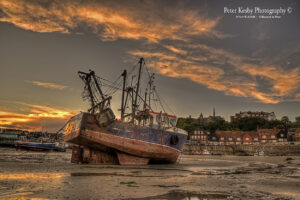 AN007 folkestone harbour fish boat in middle sunset