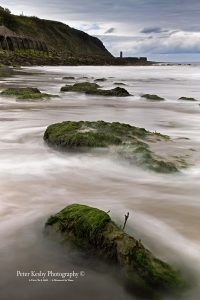 AN016 rocks on suuny sands long exposure