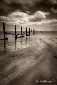 AO005 warren low tide long exposure groyne sepia portrait