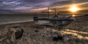 AY005 fish boiat modern fish nets hythe pano sunset